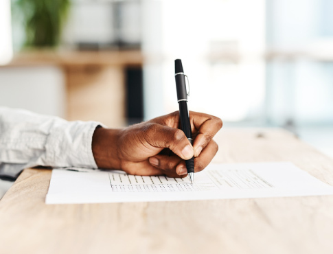 Man using pen to complete forms